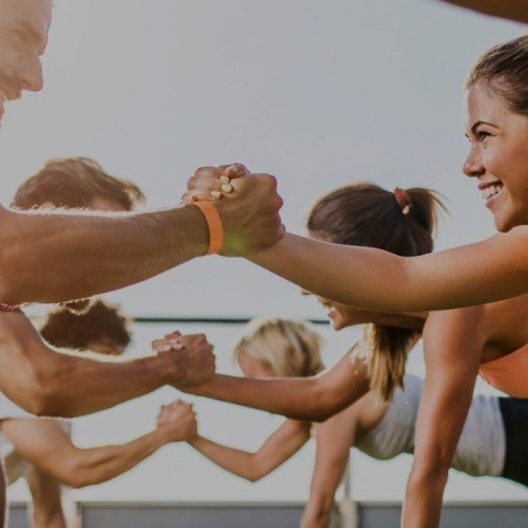 Happy Athletic People Cooperating While Exercising On A Sports Picture Id862263002