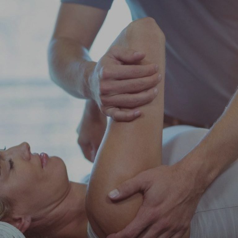 Woman Receiving Shoulder Therapy From Physiotherapist Picture Id613759142